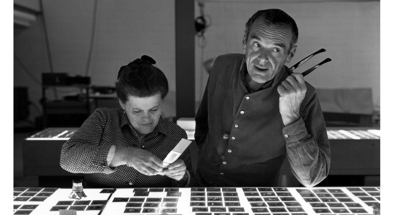 An Eames Celebration. Charles and Ray Eames selecting slides. ©Eames Office LLC